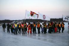 Youths from three First Nations communities cross the frozen Attawapiskat river during a march on April 7, 2016, in support of efforts to tackle a sharp rise in suicide rates, in Attawapiskat, Ontario, in this picture provided by Jackie Hookimaw-Witt. REUTERS/Jackie Hookimaw-Witt/Handout via Reuters