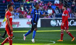 Apr 16, 2016; Chicago, IL, USA;  Montreal Impact forward Didier Drogba (11) reacts after scoring a goal against the Chicago Fire during the second half at Toyota Park. Mandatory Credit: Mike DiNovo-USA TODAY Sports