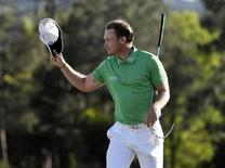 Apr 10, 2016; Augusta, GA, USA; Danny Willett reacts after putting on the 18th green in the final round of the 2016 The Masters golf tournament at Augusta National Golf Club. Michael Madrid-USA TODAY Sports