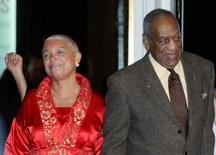 Comedian Bill Cosby and his wife Camille (L) arrive at the Kennedy Center For the Performing Arts for the Mark Twain Prize for American Humor ceremony in Washington October 26, 2009.  REUTERS/Mike Theiler/File Photo