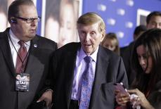 "Sumner Redstone (C), executive chairman of CBS Corp. and Viacom, is assisted as he arrives at the premiere of ""The Guilt Trip"" starring Barbra Streisand and Seth Rogen in Los Angeles in this December 11, 2012, file photo.  REUTERS/Fred Prouser/Files"