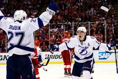 Apr 19, 2016; Detroit, MI, USA; Tampa Bay Lightning left wing Ondrej Palat (18) celebrates his goal during the third period with left wing Jonathan Drouin (27) in game four of the first round of the 2016 Stanley Cup Playoffs against the Detroit Red Wings at Joe Louis Arena. Tampa won 3-2.  Rick Osentoski-USA TODAY Sports