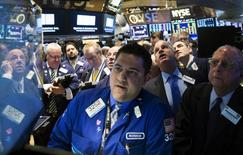 Traders wait for the opening of Whiting Petroleum's stock at the post where it's traded on the floor of the New York Stock Exchange March 24, 2015. REUTERS/Brendan McDermid