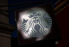 The sign of a Starbucks store is seen in New York January 24, 2014.  REUTERS/Eric Thayer