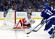 Apr 21, 2016; Tampa, FL, USA; Tampa Bay Lightning left wing Ondrej Palat (18) skates with the puck as Detroit Red Wings goalie Petr Mrazek (34) defends during the first period of game five of the first round of the 2016 Stanley Cup Playoffs at Amalie Arena.  Kim Klement-USA TODAY Sports