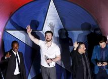 "Actors Anthony Mackie, Chris Evans, director Joe Russo and actor Sebastian Stan (L-R) wave to fans during a blue carpet event for the movie ""Captain America: Civil War"" in Singapore, April 21, 2016. REUTERS/Edgar Su"
