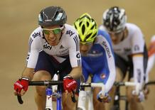 Britain's Simon Yates (L) rides to his gold medal during the men's points race at the 2013 UCI Track Cycling World Championships in Minsk February 22, 2013.  REUTERS/Vasily Fedosenko