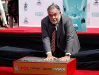 Director Francis Ford Coppola places his handprints in cement during a ceremony in the forecourt of the TCL Chinese theatre in Hollywood, U.S., April 29, 2016.   REUTERS/Mario Anzuoni