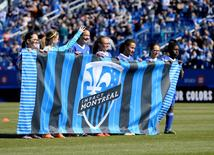 Apr 30, 2016; Montreal, Quebec, CAN; Youths hold a Montreal Impact team banner before teh game against the Colorado Rapids at Stade Saputo. Mandatory Credit: Eric Bolte-USA TODAY Sports