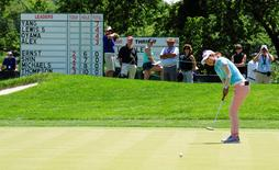 Jul 11, 2015; Lancaster, PA, USA; Jenny Shin putts on the eighth green in front of a leaderboard during the third round of the 2015 U.S. Women's Open at Lancaster Country Club. Mandatory Credit: Shanna Lockwood-USA TODAY Sports - RTX1K0N2