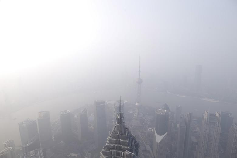 A general view of Shanghai's financial district of Pudong ais seen from the Shanghai World Financial Center amid heavy smog in Shanghai, China, December 25, 2015. REUTERS/Aly Song