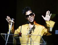 Musician Prince gestures on stage during the Apollo Theatre's 75th anniversary gala in New York, June 8, 2009. REUTERS/Lucas Jackson/Files