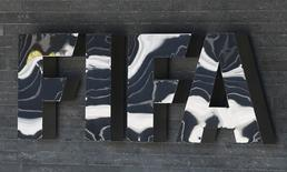 The FIFA logo is seen at the FIFA headquarters in Zurich, Switzerland March 18, 2016. REUTERS/Ruben Sprich/Files