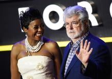 George Lucas and his wife Mellody Hobson arrive at the European Premiere of Star Wars, The Force Awakens in Leicester Square, London, December 16, 2015.       REUTERS/Dylan Martinez