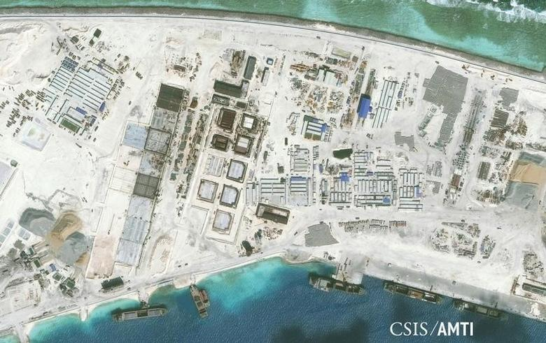 The northwest side of Mischief Reef showing a 1,900 foot seawall and newly-constructed infrastructure including housing, an artificial turf parade grounds, cement plants, and docking facilities are shown in this Center for Strategic and International Studies (CSIS) Asia Maritime Transparency Initiative January 8, 2016 satellite image released to Reuters on January 15, 2016. REUTERS/CSIS Asia Maritime Transparency Initiative/Digital Globe/Handout via Reuters