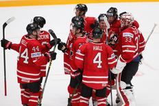 Ice Hockey - 2016 IIHF World Championship - Group B - St. Petersburg, Russia - 6/5/16 - Canada players celebrate victory over U.S. REUTERS/Maxim Zmeyev