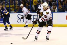 Apr 21, 2016; St. Louis, MO, USA; Chicago Blackhawks right wing Patrick Kane (88) passes the puck during the first period in game five of the first round of the 2016 Stanley Cup Playoffs against the St. Louis Blues at Scottrade Center. The Blackhawks won the game 4-3 in double overtime. Mandatory Credit: Billy Hurst-USA TODAY Sports
