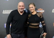 Sep 9, 2014; Los Angeles, CA, USA; UFC Women's Bantamweight champion Ronda Rousey and UFC president Dana White arrive on the Red Carpet at Lure Nightclub for the premier of The Ultimate Fighter women in the newly formed women in the strawweight class. Mandatory Credit: Jayne Kamin-Oncea-USA TODAY Sports