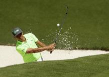 Apr 7, 2016; Augusta, GA, USA; Rickie Fowler hits out of a bunker on the 10th hole during the first round of the 2016 The Masters golf tournament at Augusta National Golf Club. Mandatory Credit: Rob Schumacher-USA TODAY Sports