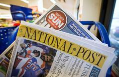 Toronto Sun and National Post newspapers are posed in front of a news stand in Toronto, in this October 6, 2014 file photo. REUTERS/Mark Blinch