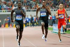 Justin Gatlin (L) of the U.S. competes.   Athletics - IAAF Athletics Diamond League meeting - Men's 100m - Shanghai Stadium, Shanghai, China - 14/5/16. REUTERS/Aly Song