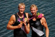 Gold medallists Eric Murray (L) and Hamish Bond of New Zealand celebrate during the medals ceremony after winning the Men's Pair Final event during the London 2012 Olympic Games at Eton Dorney August 3, 2012.      REUTERS/Mark Blinch