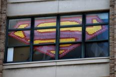 An image of the Superman Logo created with Post-it notes is seen in windows at 200 Hudson street in lower Manhattan, New York, May 18, 2016. REUTERS/Mike Segar