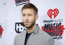 DJ Calvin Harris poses at the 2016 iHeartRadio Music Awards in Inglewood, California, April 3, 2016. REUTERS/Danny Moloshok
