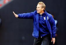 The U.S. team coach Jurgen Klinsmann gestures during the international friendly soccer match against Switzerland at the Letzigrund Stadium in Zurich March 31, 2015. REUTERS/Arnd Wiegmann