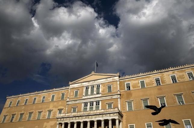A Greek national flag flutters atop the parliament building in Athens, Greece April 11, 2016. REUTERS/Alkis Konstantinidis