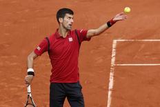 Tennis - French Open - Roland Garros - Novak Djokovic of Serbia vs Yen-Hsun Lu of Taiwan - Paris, France - 24/05/16. Novak Djokovic serves the ball. REUTERS/Benoit Tessier