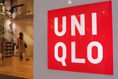 Shoppers walk inside Fast Retailing's Uniqlo casual clothing store in Tokyo, Japan July 10, 2014. REUTERS/Toru Hanai/File Photo