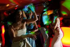 Precious Perez, 18, who has been blind since birth, dances with her friend Maddy Wilson (R) at the Chelsea High School Prom in Boston, Massachusetts, United States May 21, 2016. REUTERS/Brian Snyder