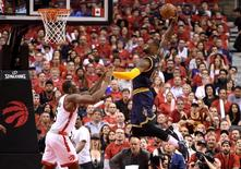 May 23, 2016; Toronto, Ontario, CAN;  Cleveland Cavaliers forward LeBron James (23) goes up to dunk for a basket over Toronto Raptors center Bismack Biyombo (8) in the second quarter in game four of the Eastern conference finals of the NBA Playoffs at Air Canada Centre. Mandatory Credit: Dan Hamilton-USA TODAY Sports