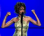 "Singer Whitney Houston performs the song ""Try It On My Own"" during the ""VH1 Divas Duets"" concert at the MGM Grand Garden Arena in Las Vegas, Nevada, May 22, 2003.   REUTERS/Ethan Miller"