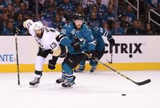 San Jose Sharks center Chris Tierney (50) battles for the puck with Pittsburgh Penguins center Nick Bonino (13) in the third period of game three of the 2016 Stanley Cup Final at SAP Center at San Jose. Mandatory Credit: Kyle Terada-USA TODAY Sports