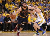 June 2, 2016; Oakland, CA, USA; Cleveland Cavaliers forward Kevin Love (0) moves the ball against Golden State Warriors guard Klay Thompson (11) during the first half in game one of the NBA Finals at Oracle Arena. Mandatory Credit: Kyle Terada-USA TODAY Sports
