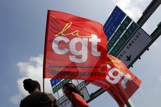 Striking employees of Roissy airport hold French CGT labour union flags during a demonstration against the labour reforms law at the Charles de Gaulle International Airport in Roissy, near Paris, France, June 7, 2016.   REUTERS/Philippe Wojazer