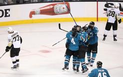 Jun 6, 2016; San Jose, CA, USA; The San Jose Sharks celebrate a goal by San Jose Sharks right wing Melker Karlsson (68) as they play the Pittsburgh Penguins in the third period in game four of the 2016 Stanley Cup Final at SAP Center at San Jose. Mandatory Credit: John Hefti-USA TODAY Sports