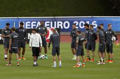Germany's coach Joachim Loew and players during training.    REUTERS/Denis Balibouse