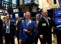 Traders observe a moment of silence before the opening bell to honor the victims of the shooting at the Pulse night club in Orlando, Florida, on the floor of the New York Stock Exchange (NYSE) in New York City, U.S., June 13, 2016.  REUTERS/Brendan McDermid