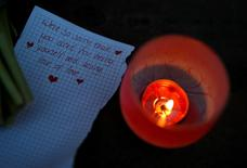 A handwritten note is left following a candlelit vigil in memory of the victims of the gay nightclub mass shooting in Orlando, outside St Georges Hall in Liverpool, northern England, June 13, 2016. REUTERS/Phil Nobe