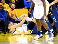 Jun 13, 2016; Oakland, CA, USA; Golden State Warriors center Andrew Bogut (12) reacts after being injured during the third quarter against the Cleveland Cavaliers in game five of the NBA Finals at Oracle Arena. Mandatory Credit: Bob Donnan-USA TODAY Sports
