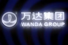 A sign of Dalian Wanda Group in China glows during an event announcing strategic partnership between Wanda Group and FIFA in Beijing, China March 21, 2016. REUTERS/Damir Sagolj/File Photo