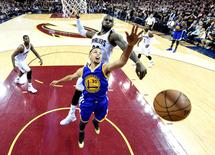 Jun 16, 2016; Cleveland, OH, USA; Cleveland Cavaliers forward LeBron James (23) blocks a shot by Golden State Warriors guard Stephen Curry (30) during the fourth quarter in game six of the NBA Finals at Quicken Loans Arena. Mandatory Credit: Bob Donnan-USA TODAY Sports