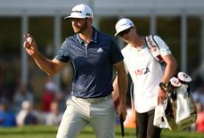 Jun 19, 2016; Oakmont, PA, USA; Dustin Johnson waves to the crowd after putting on the 13th green during the final round of the U.S. Open golf tournament at Oakmont Country Club. Mandatory Credit: John David Mercer-USA TODAY Sports