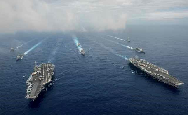 The Nimitz-class aircraft carriers USS John C. Stennis (CVN 74), and USS Ronald Reagan (CVN 76) (R) conduct dual aircraft carrier strike group operations in the U.S. 7th Fleet area of operations in support of security and stability in the Indo-Asia-Pacific in the Philippine Sea on June 18, 2016.   Courtesy Jake Greenberg/U.S. Navy/Handout via REUTERS