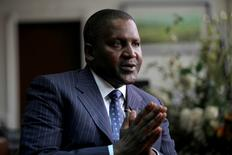 Founder and Chief Executive of the Dangote Group Aliko Dangote gestures during an interview with Reuters in his office in Lagos, Nigeria, June 13, 2012. REUTERS/Akintunde Akinleye/File Photo