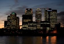 The Canary Wharf financial district is seen at dusk in east London, Britain November 7, 2014.  REUTERS/Toby Melville/File Photo