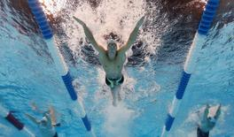 Jun 28, 2016; Omaha, NE, USA; Michael Phelps swims during the men's butterfly 200m preliminary heats in the U.S. Olympic swimming team trials at CenturyLink Center. Mandatory Credit: Rob Schumacher-USA TODAY Sports